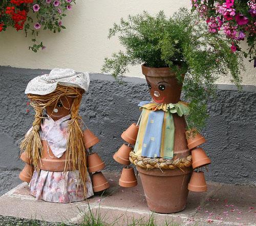 vyro, moters lėlės pagamintos iš vazonėlių